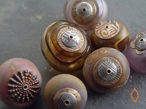 Tube riveted and capped hollow beads