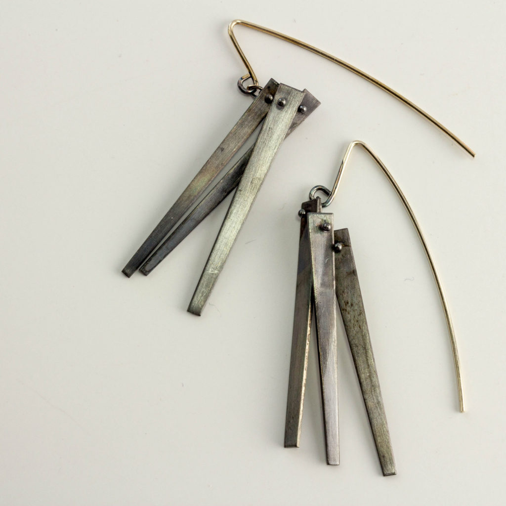these earrings use a design element inspired by the sword like leaf of the yucca plant