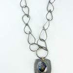 Statement necklace with glass cabochon that sparkles